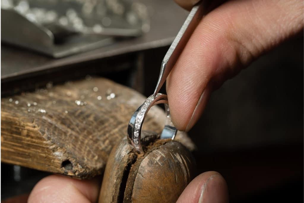 Man resetting jewellery.